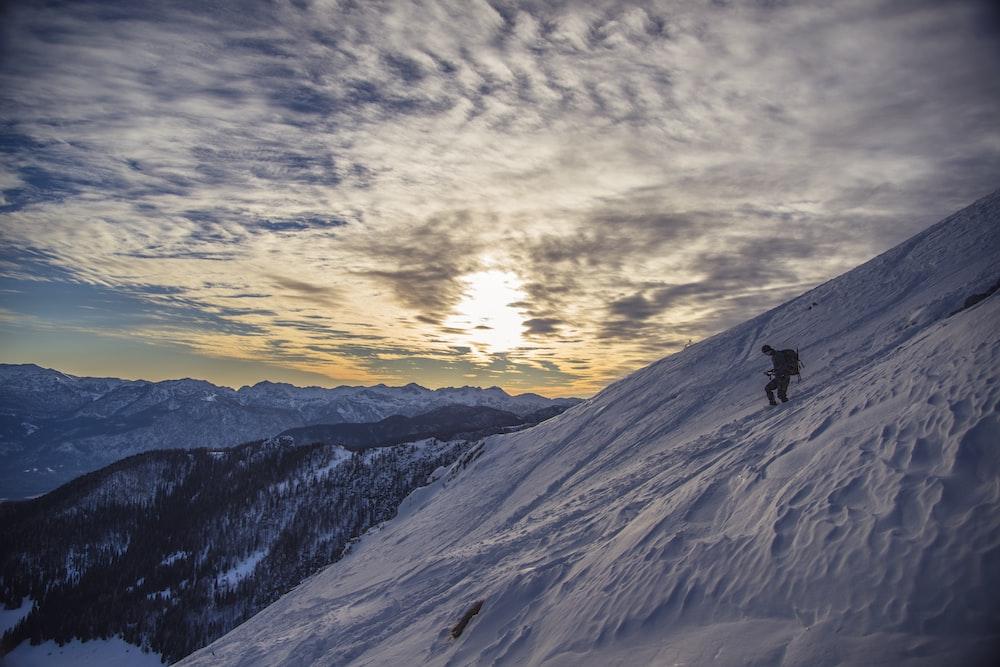 man walking on top of the mountain during daytime