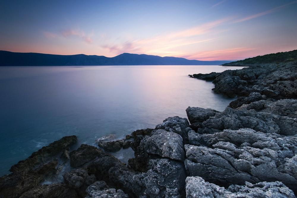 gray rock formation near body water