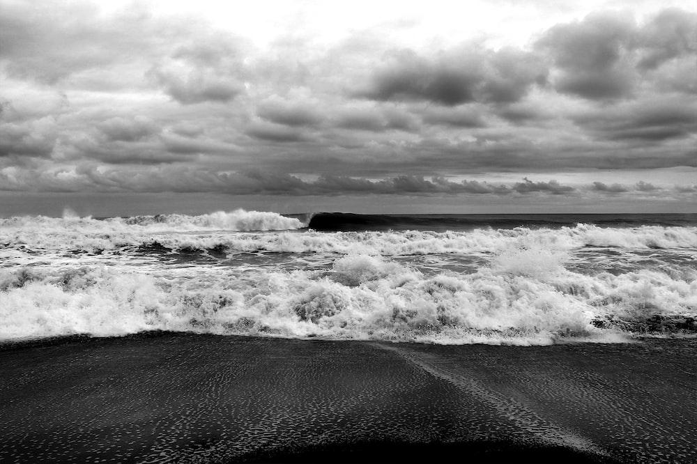 grayscale photography of seashore