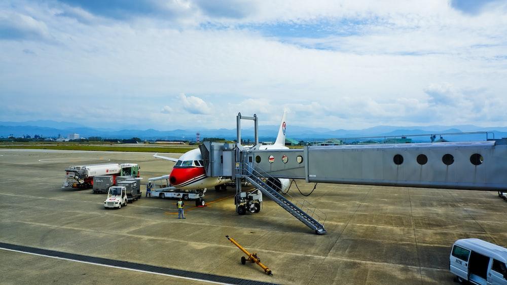 passenger plane beside tunnel passenger