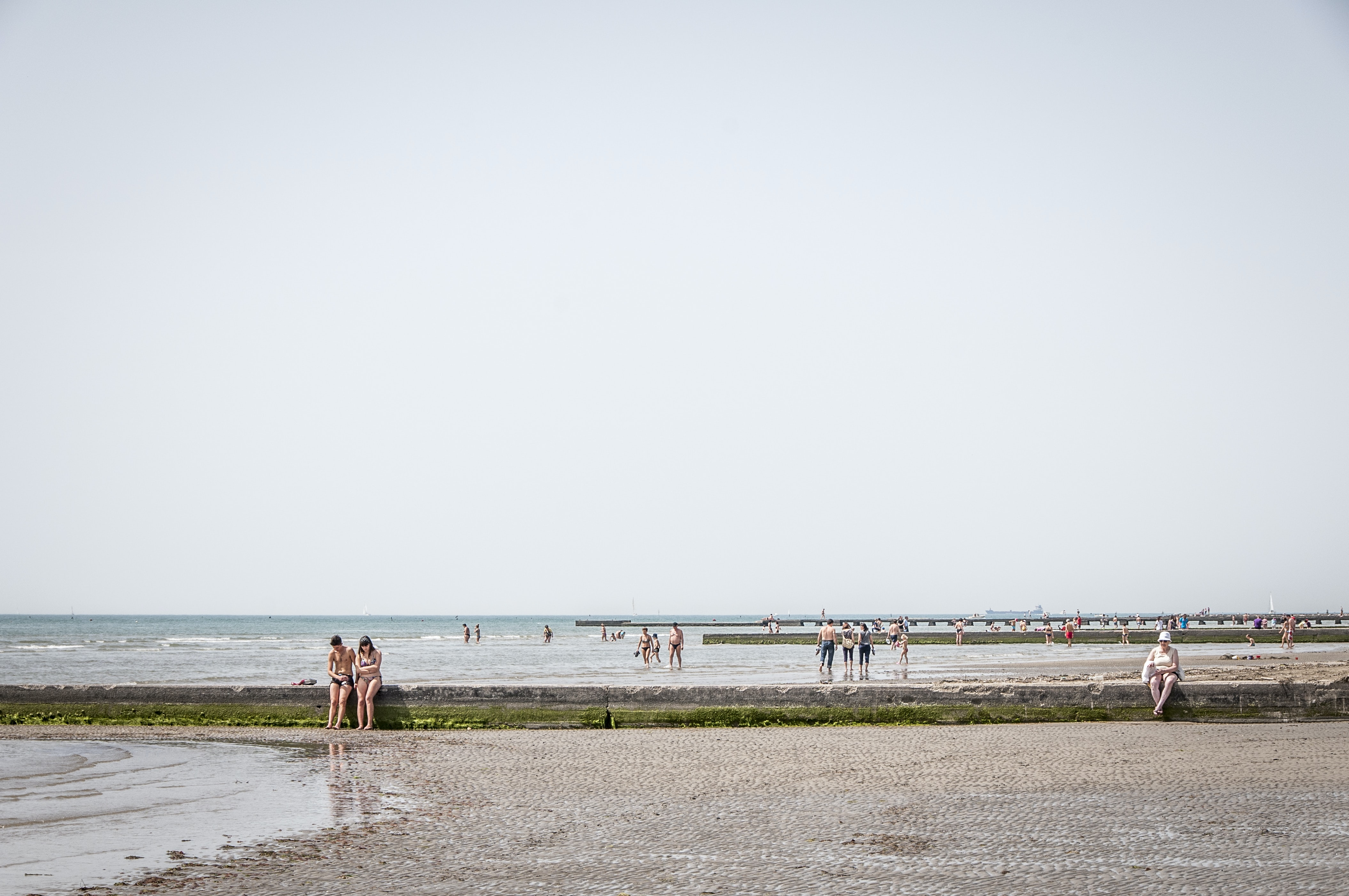 Happy people and couple enjoying time on beach in Grado Italy