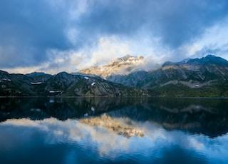 parorama photography of mountain under cloudy sky
