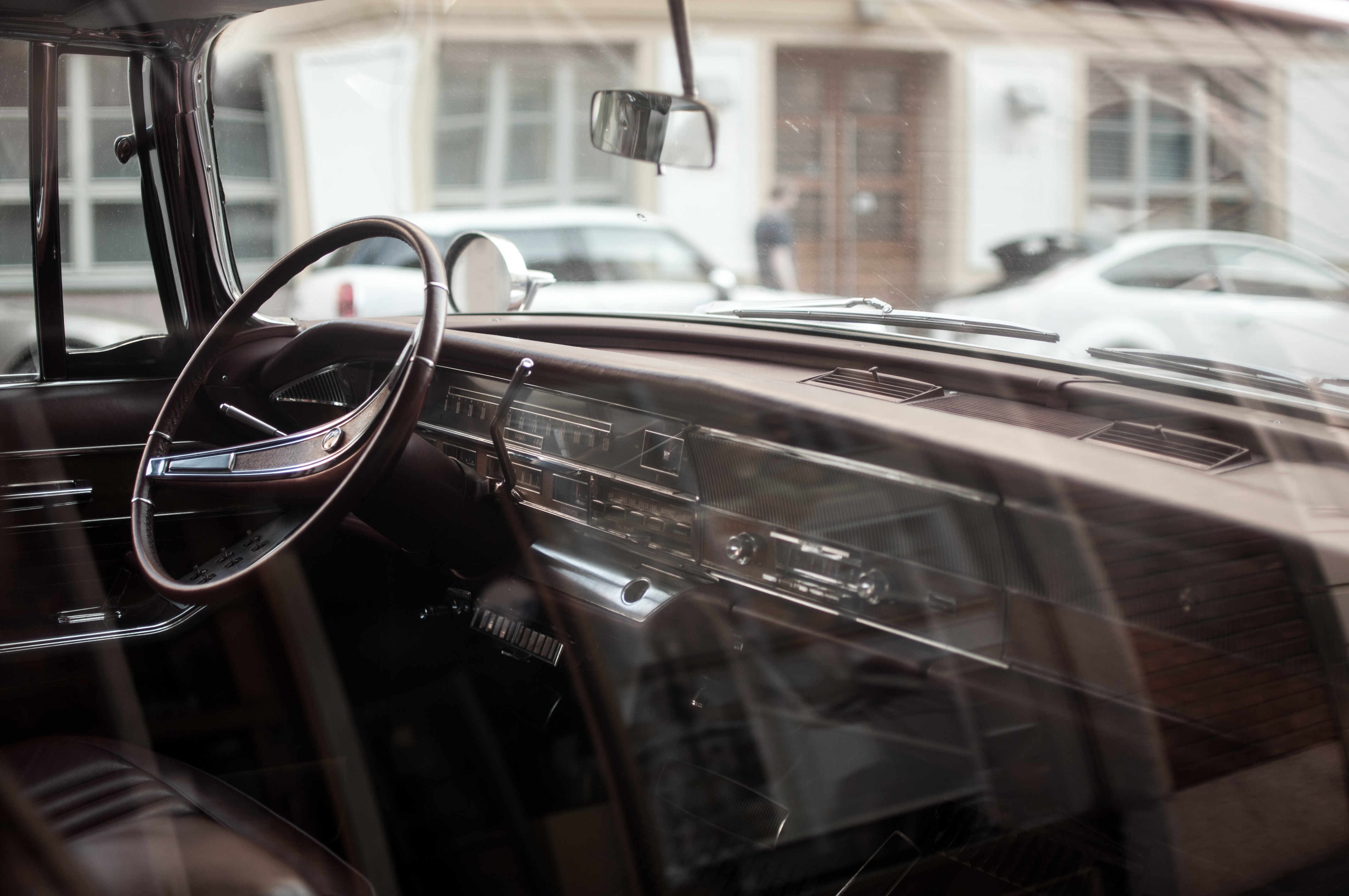The inside and dashboard of a vintage car