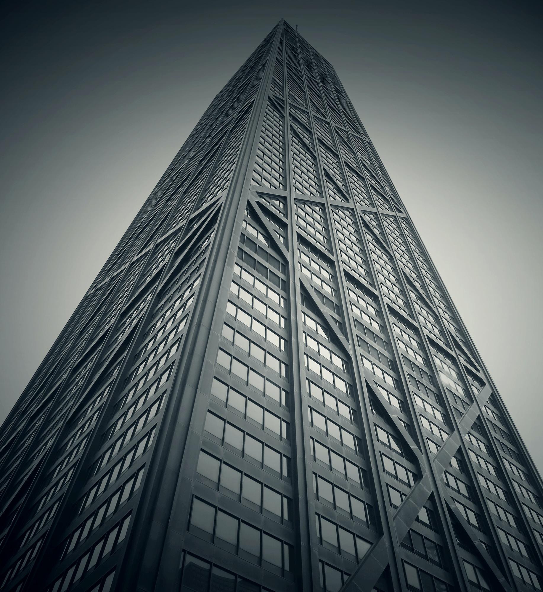 A desaturated shot of a tall skyscraper