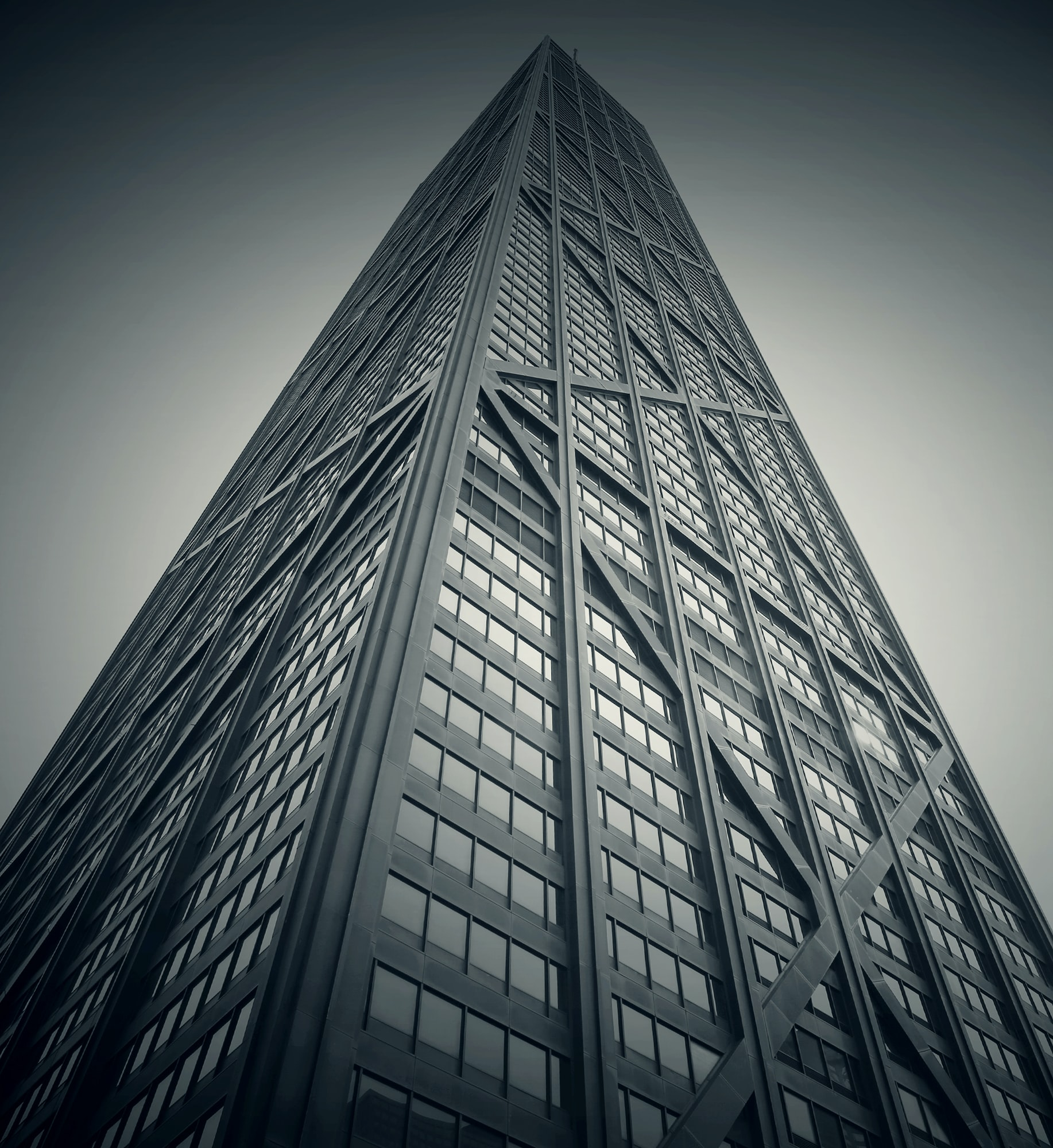 A desaturated shot of a tall skyscraper