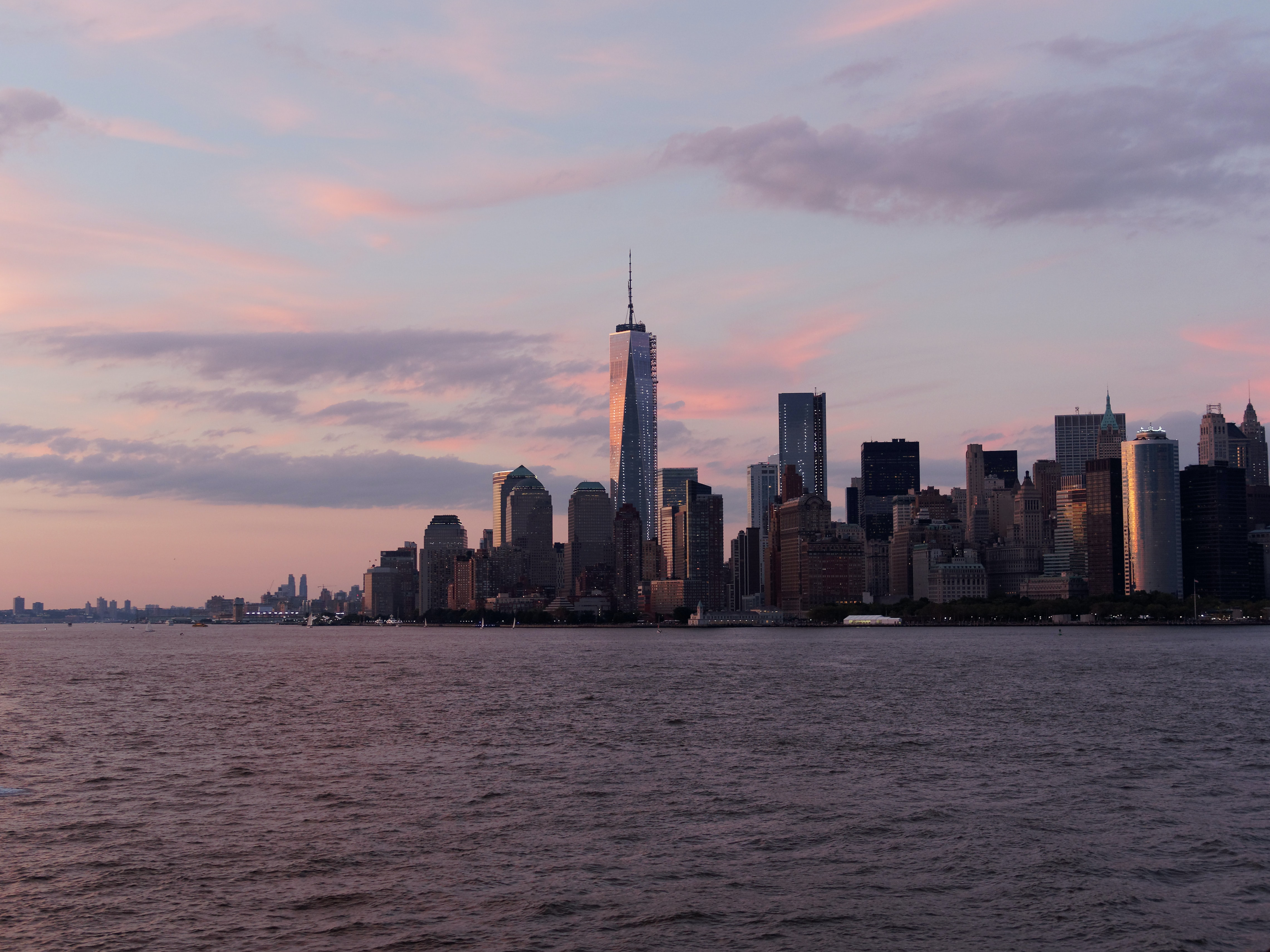 A shot of the freedom tower at dawn flaunting its architectural designs by the Oceanside among other skyscrapers