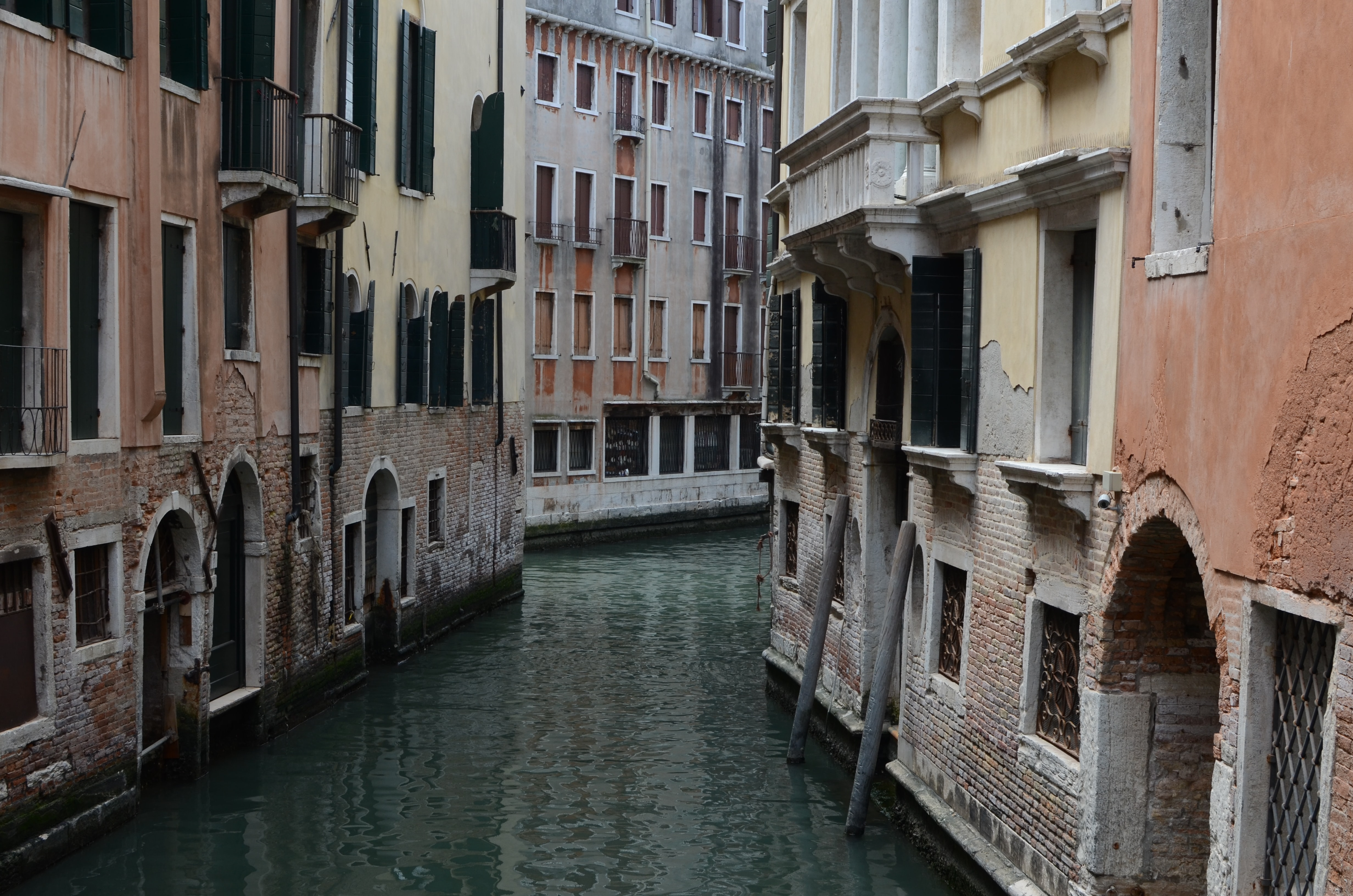Two old buildings separated by a canal in Venice, Europe.