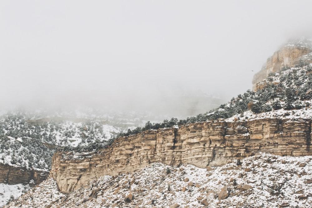 rocky mountain under gray sky at daytime