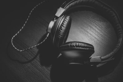 Headphones on wood in black and white