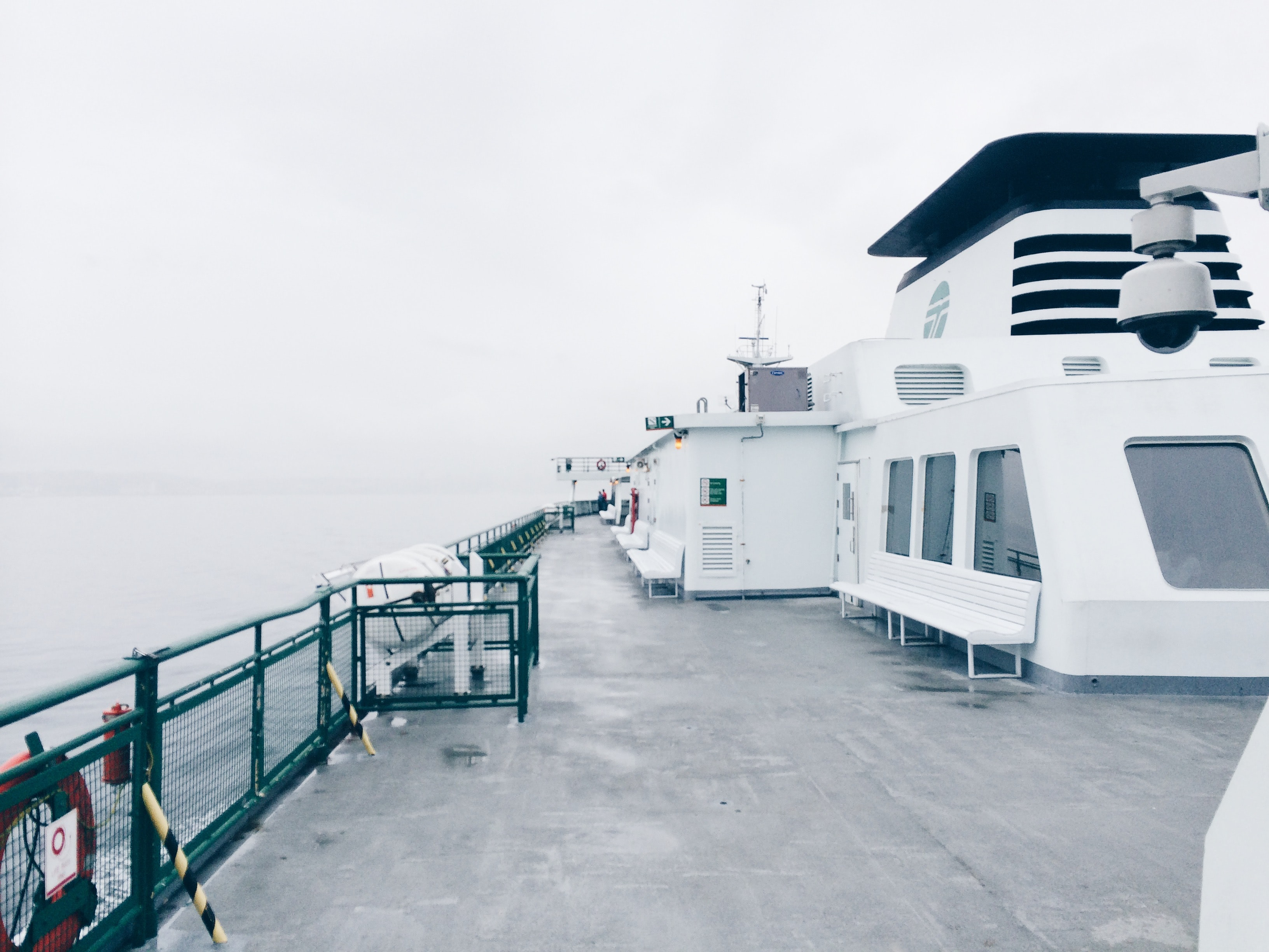A desaturated photo of a ferry vessel's deck.
