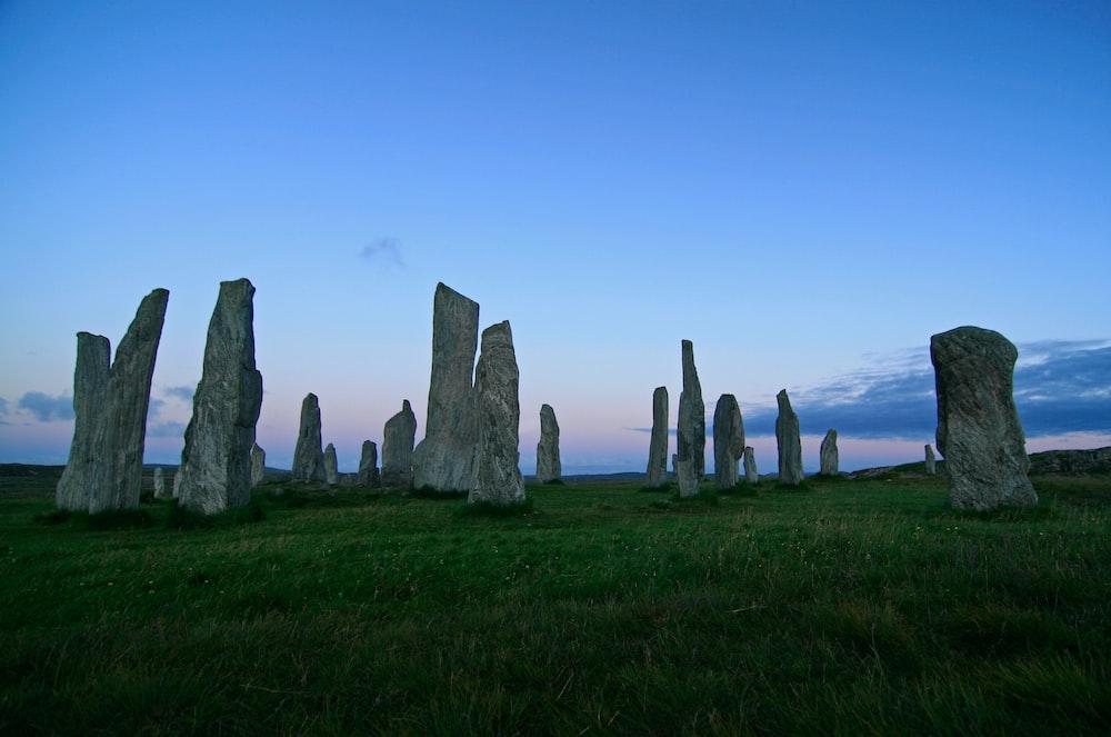lined rocks on green grass field landmark