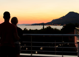silhouette of couple on terrace