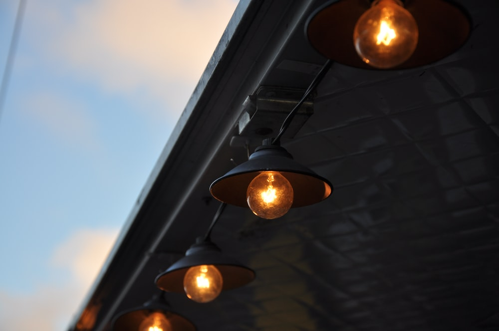 orange lighted bulbs under roof