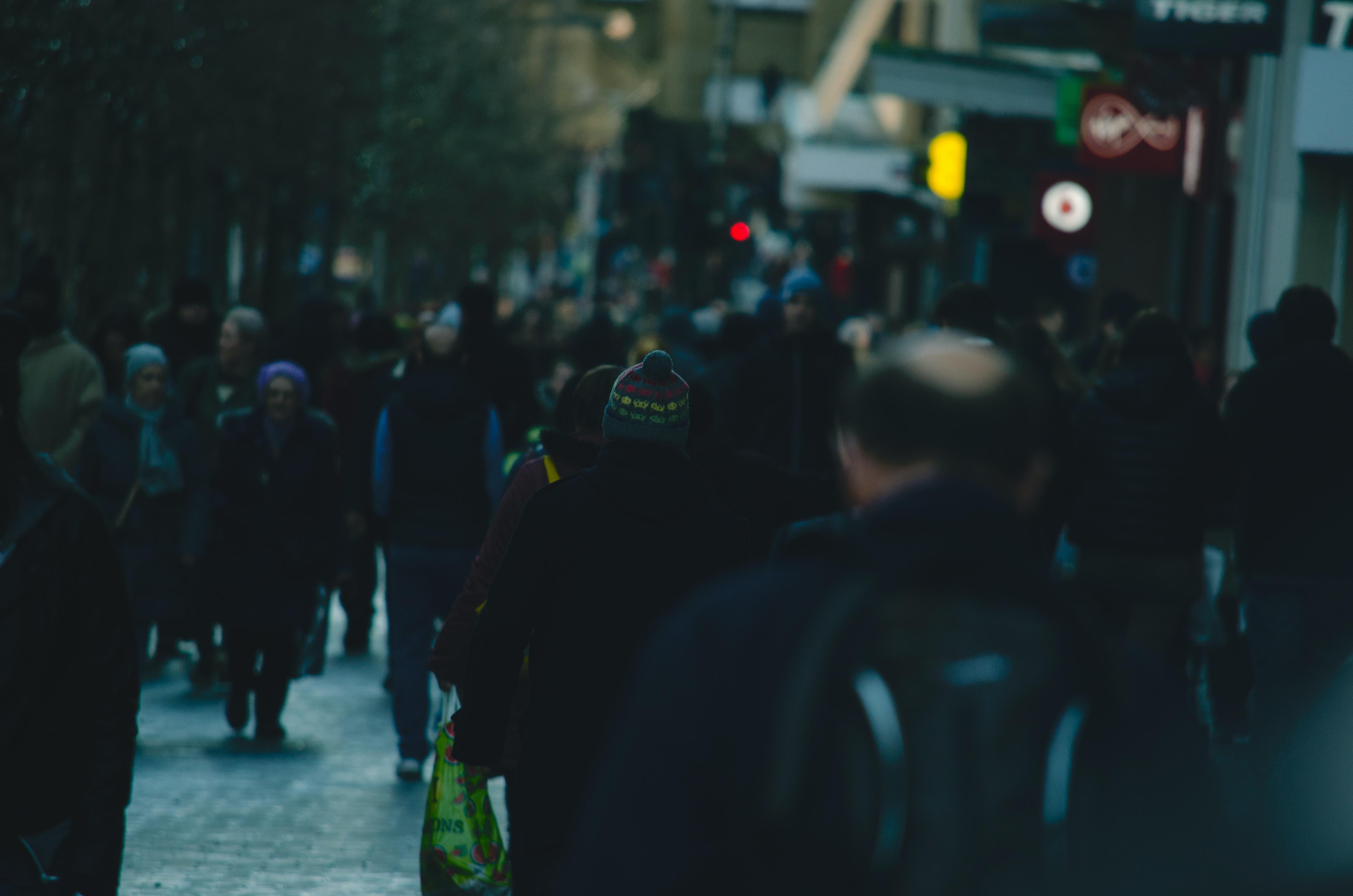 people walking on street near building