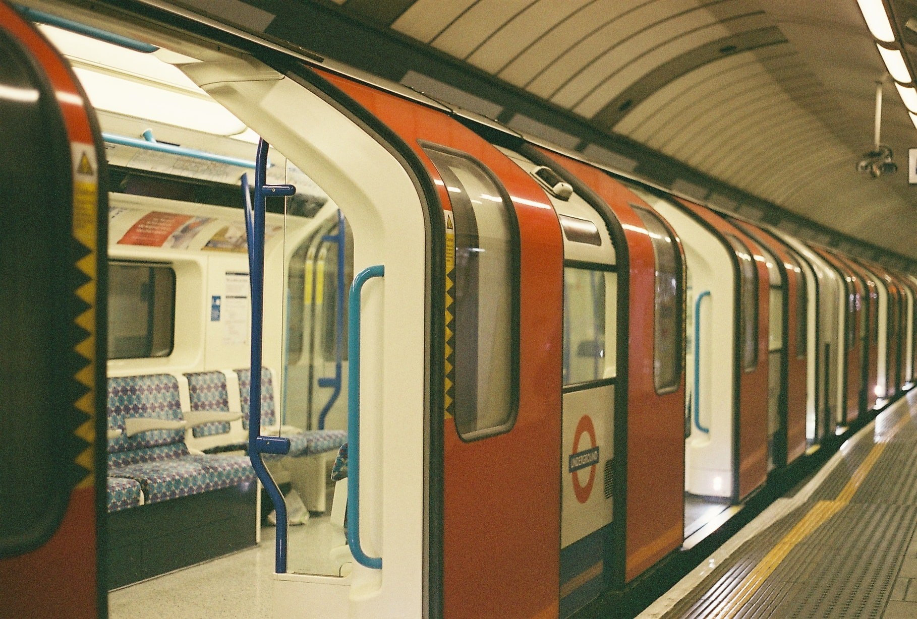 An empty London Underground train at a station