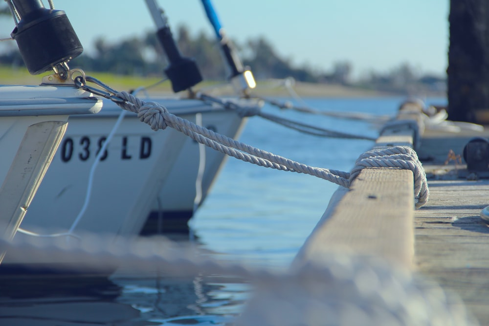 shallow focus photography of boats on body of water