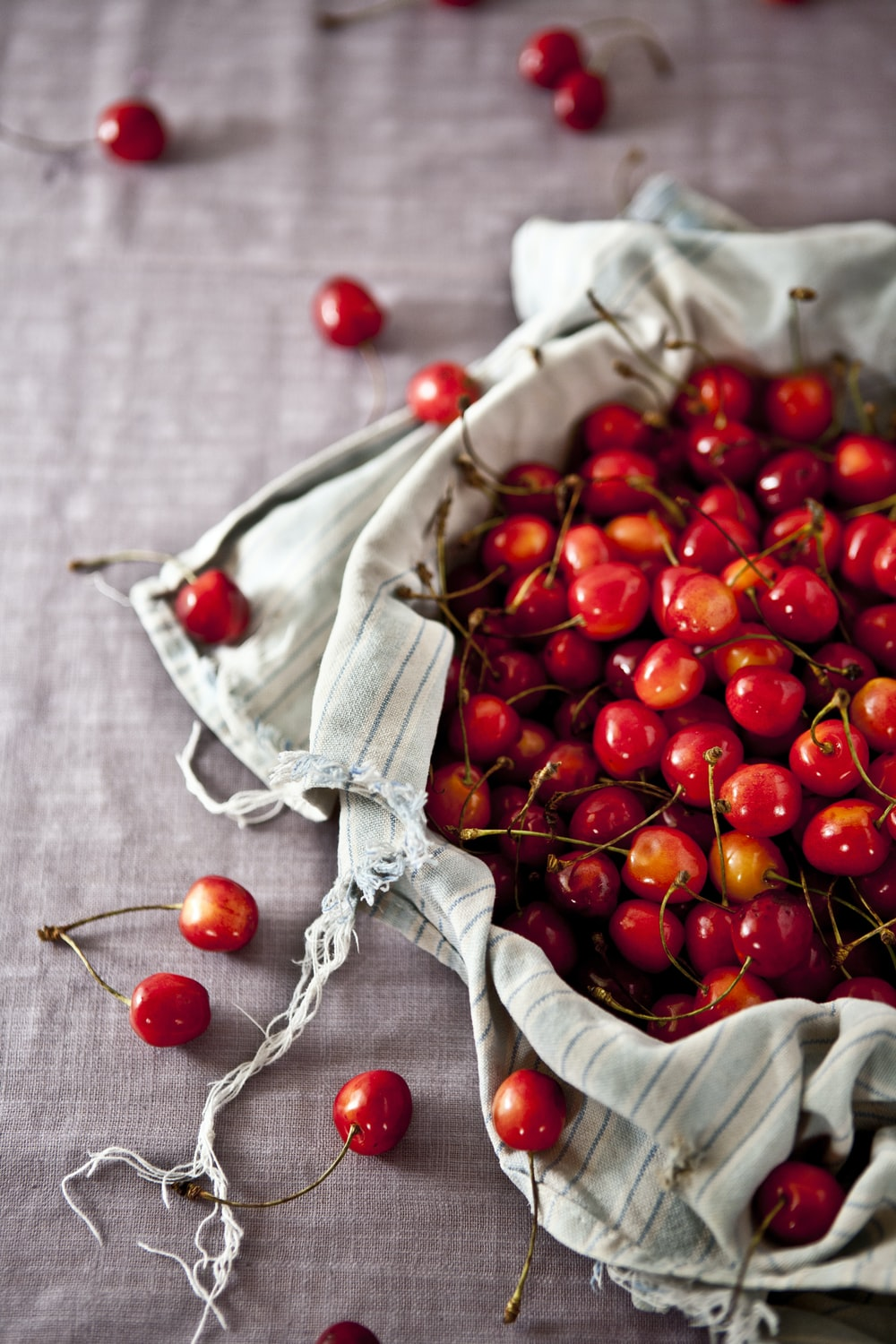 shallow focus photography of cherry fruits