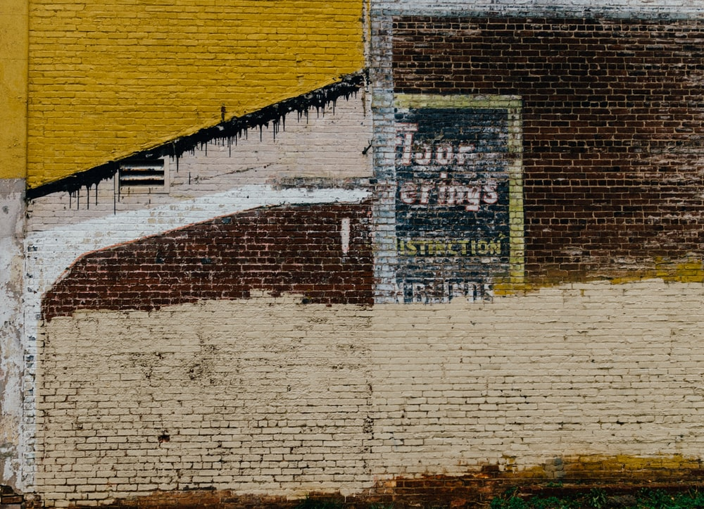 brown, yellow, and beige concrete brick wall