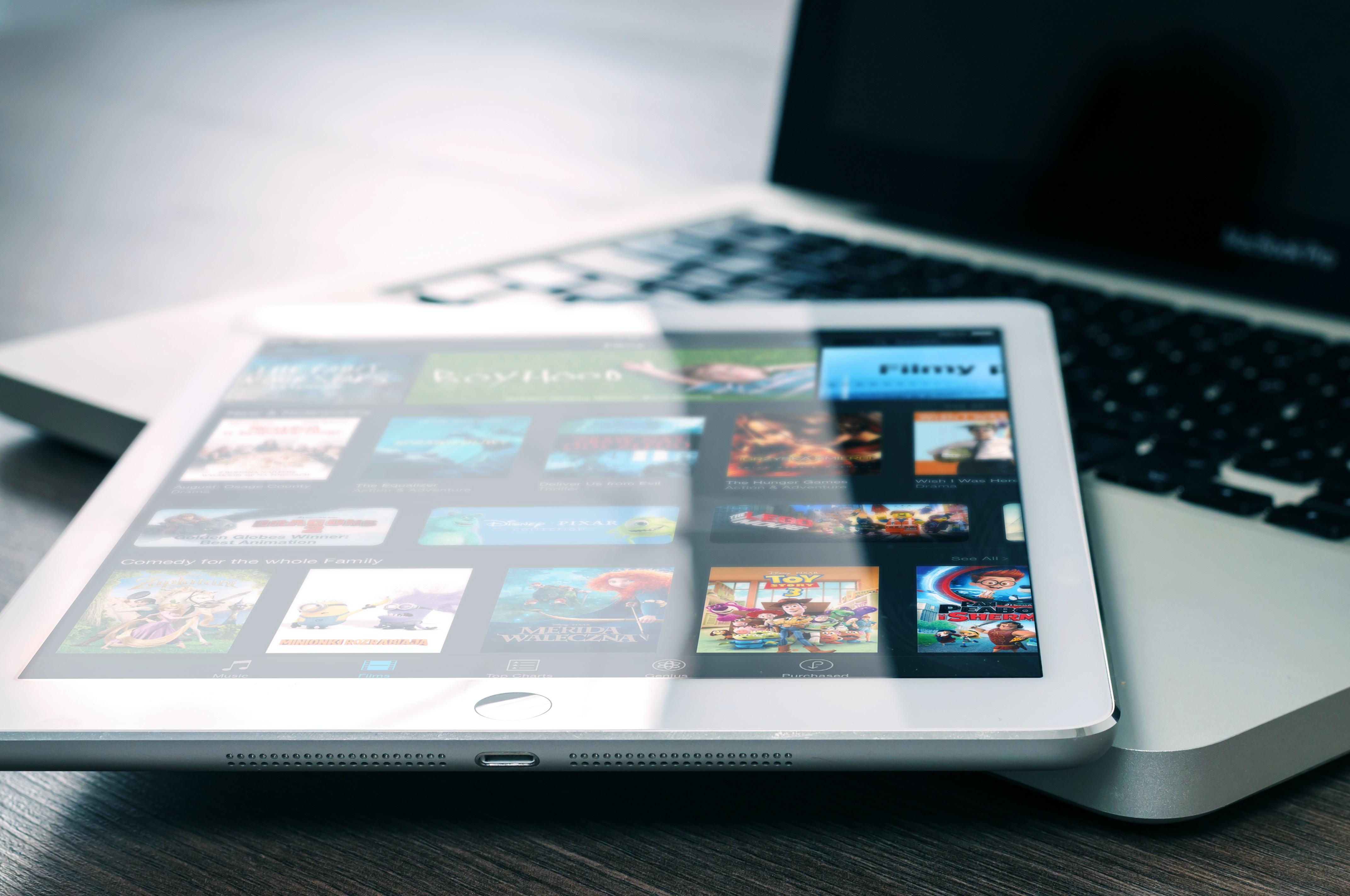 silver iPad on top of MacBook Pro