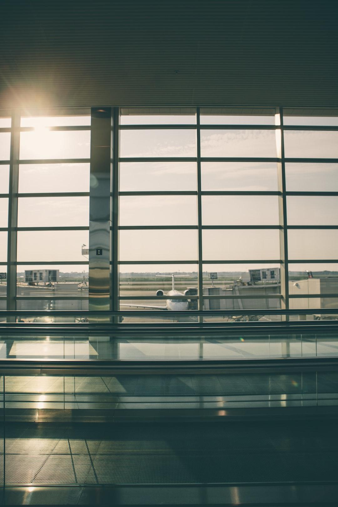 airport terminal window sun