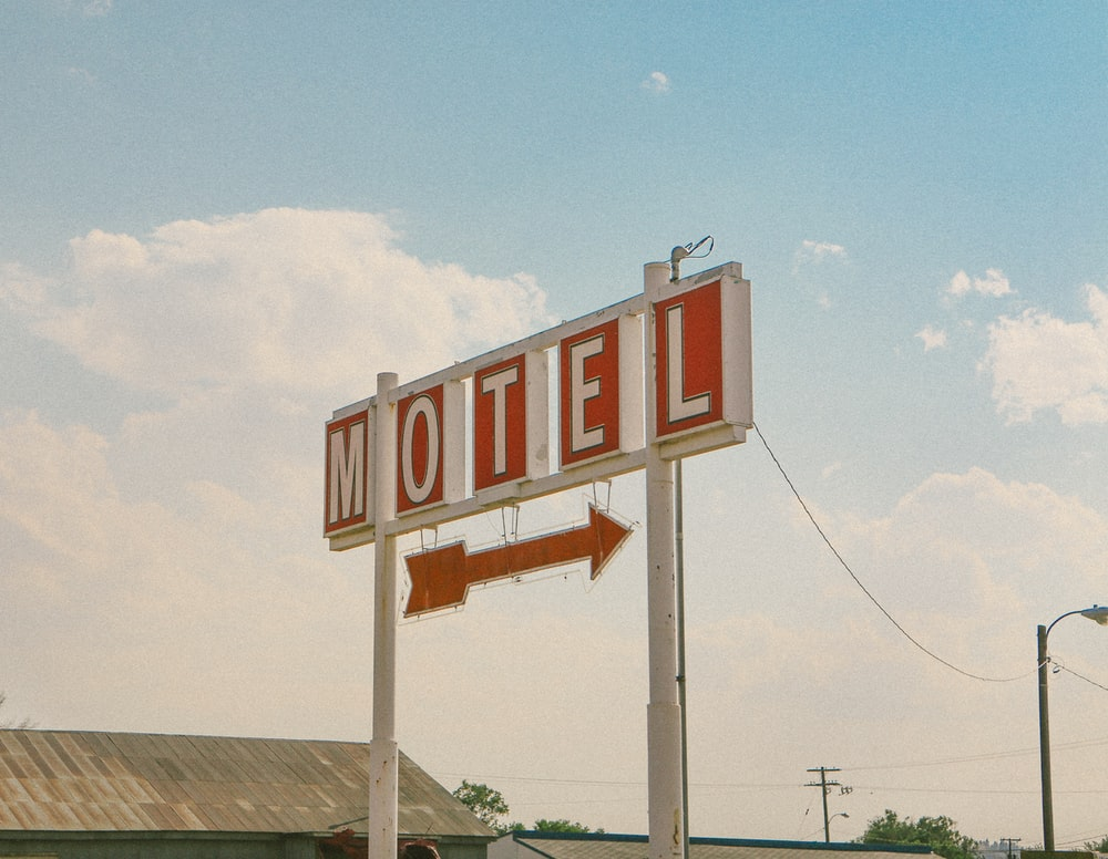 red and white motel signage