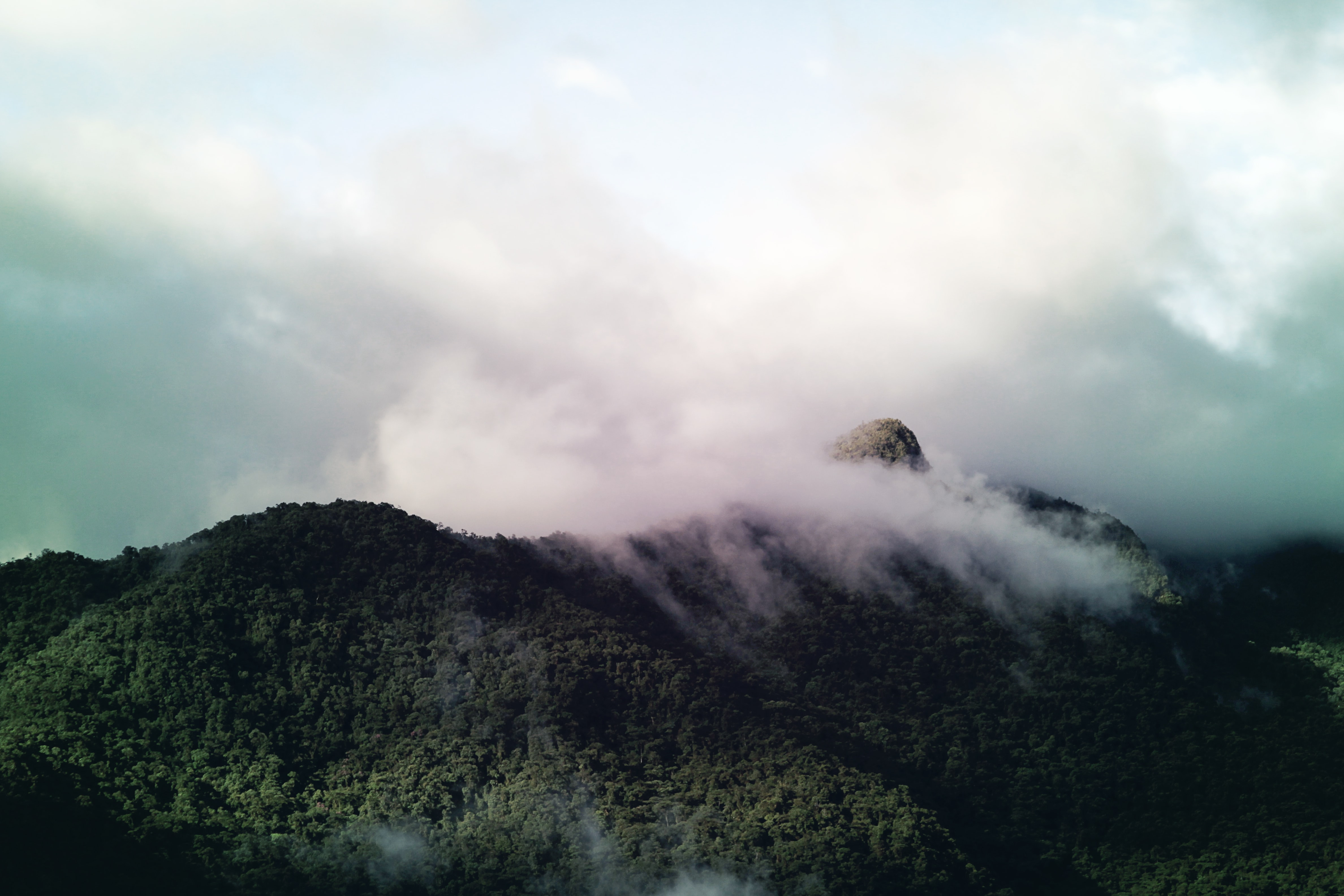 landscape photography of mountain with cloudy sky