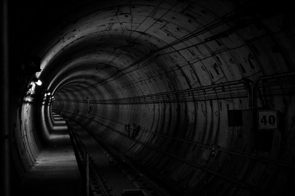 grayscale photo train subway