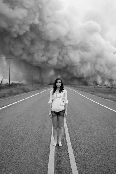 woman and road smoke cloud