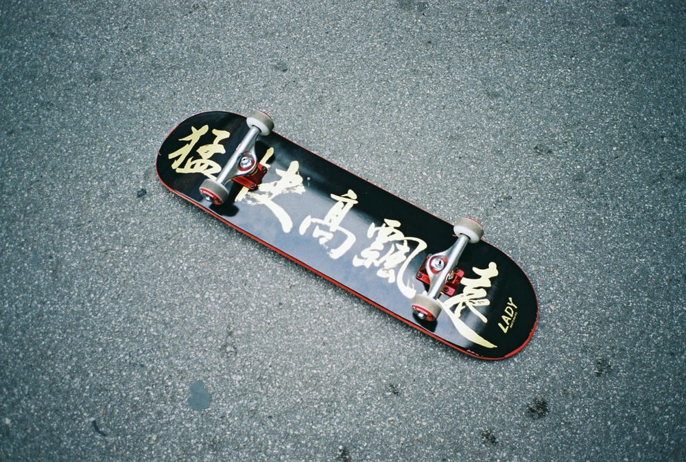 black skateboard on gray surface