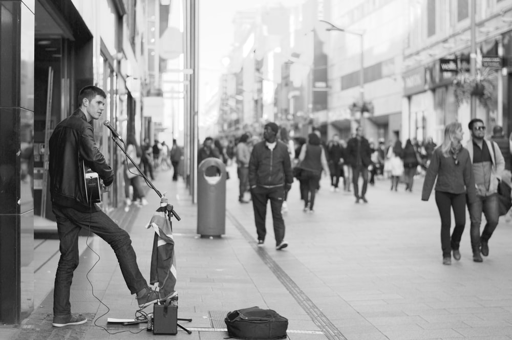 man playing musical instrument at town