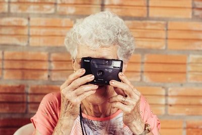 woman holding film camera old teams background