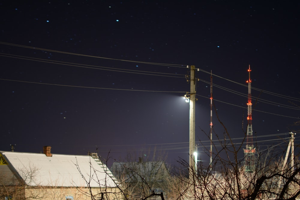 gray electric post during nighttime