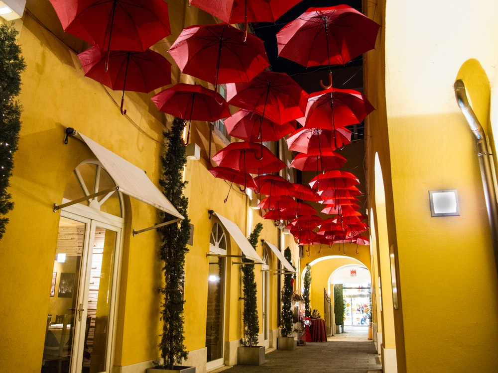 pathway covered by red umbrellas
