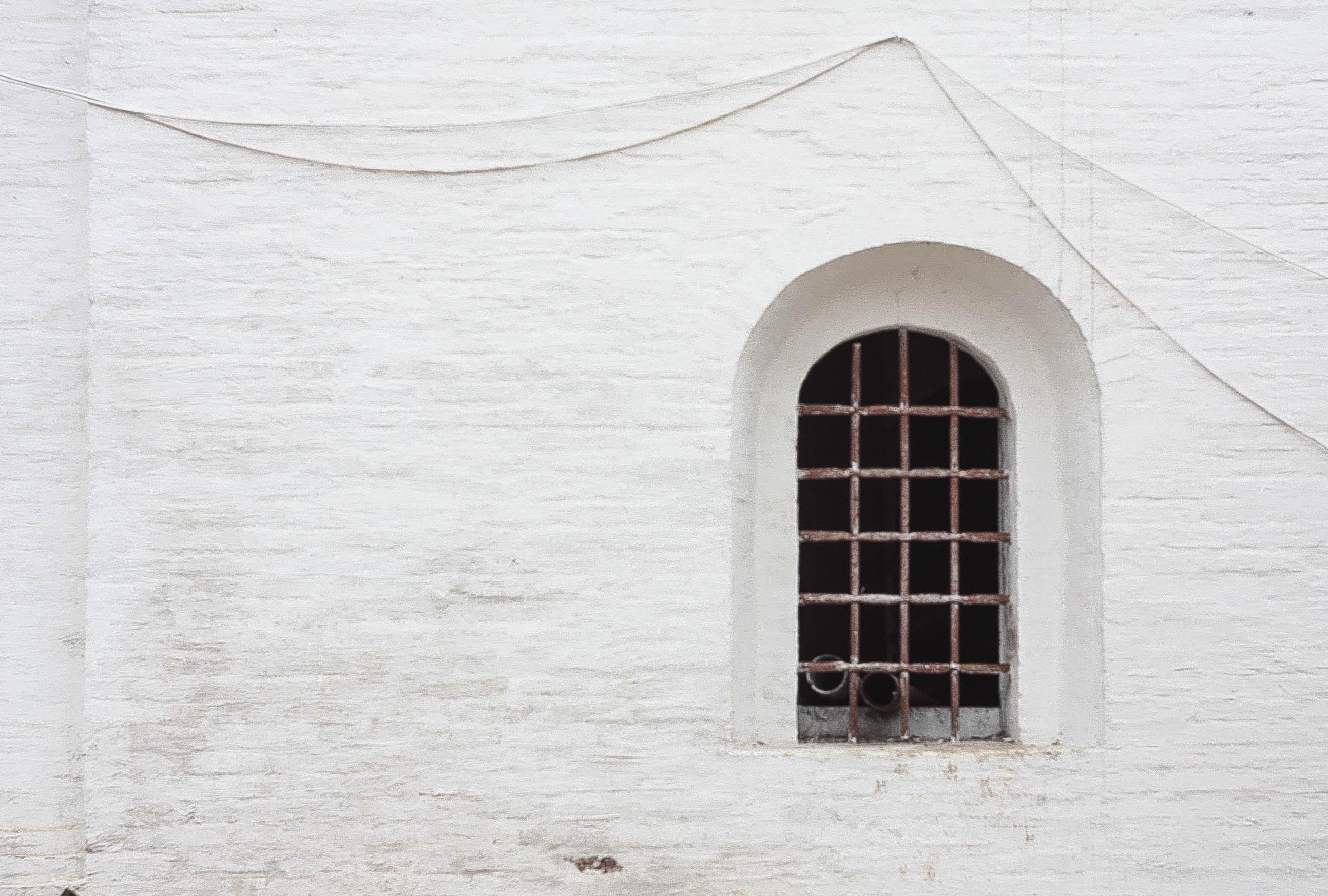 closeup photo of metal window