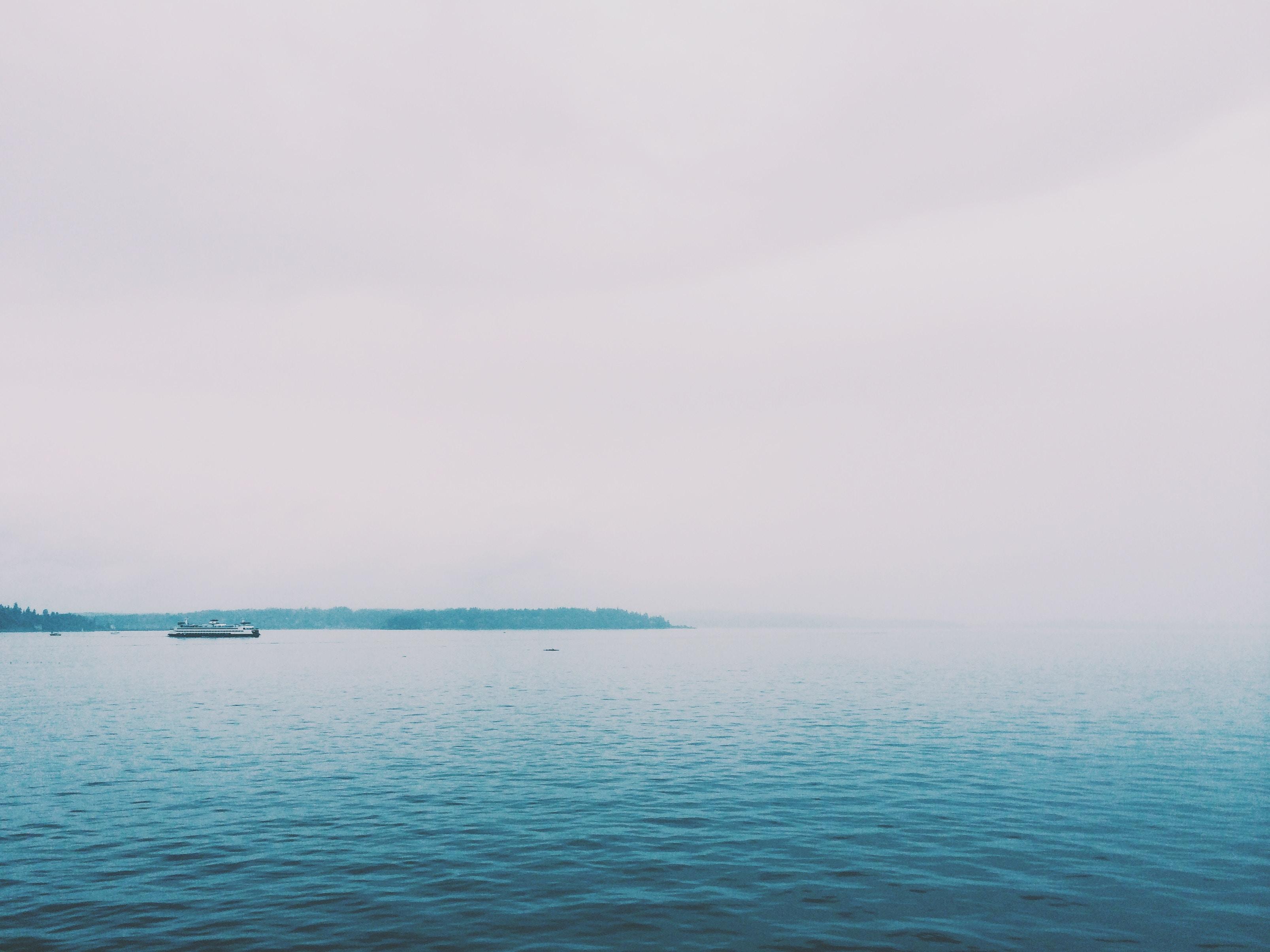 blue sea under gray sky