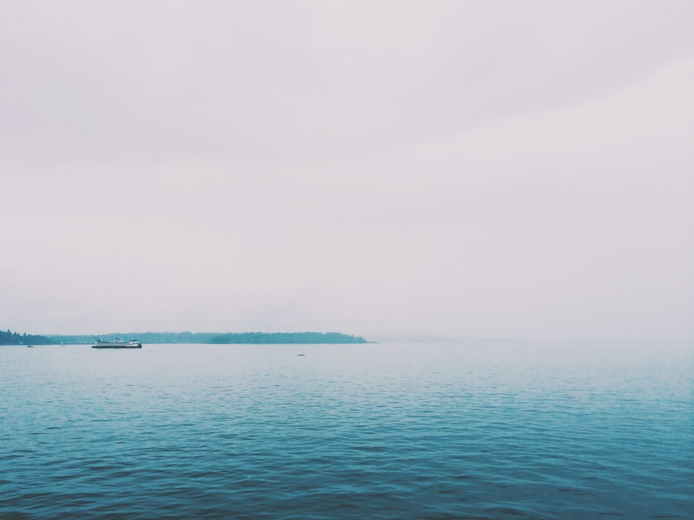 blue sea under gray sky