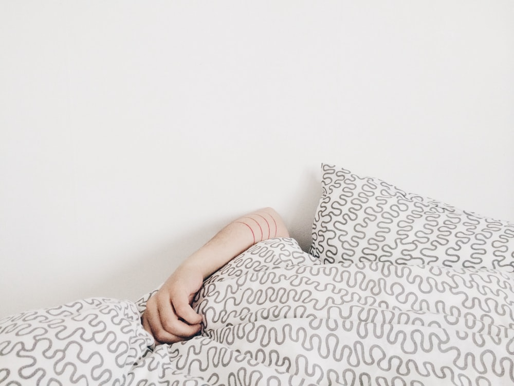 person lying on bed