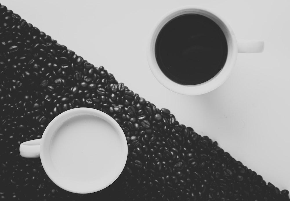white ceramic coffee mug filled with black liquid