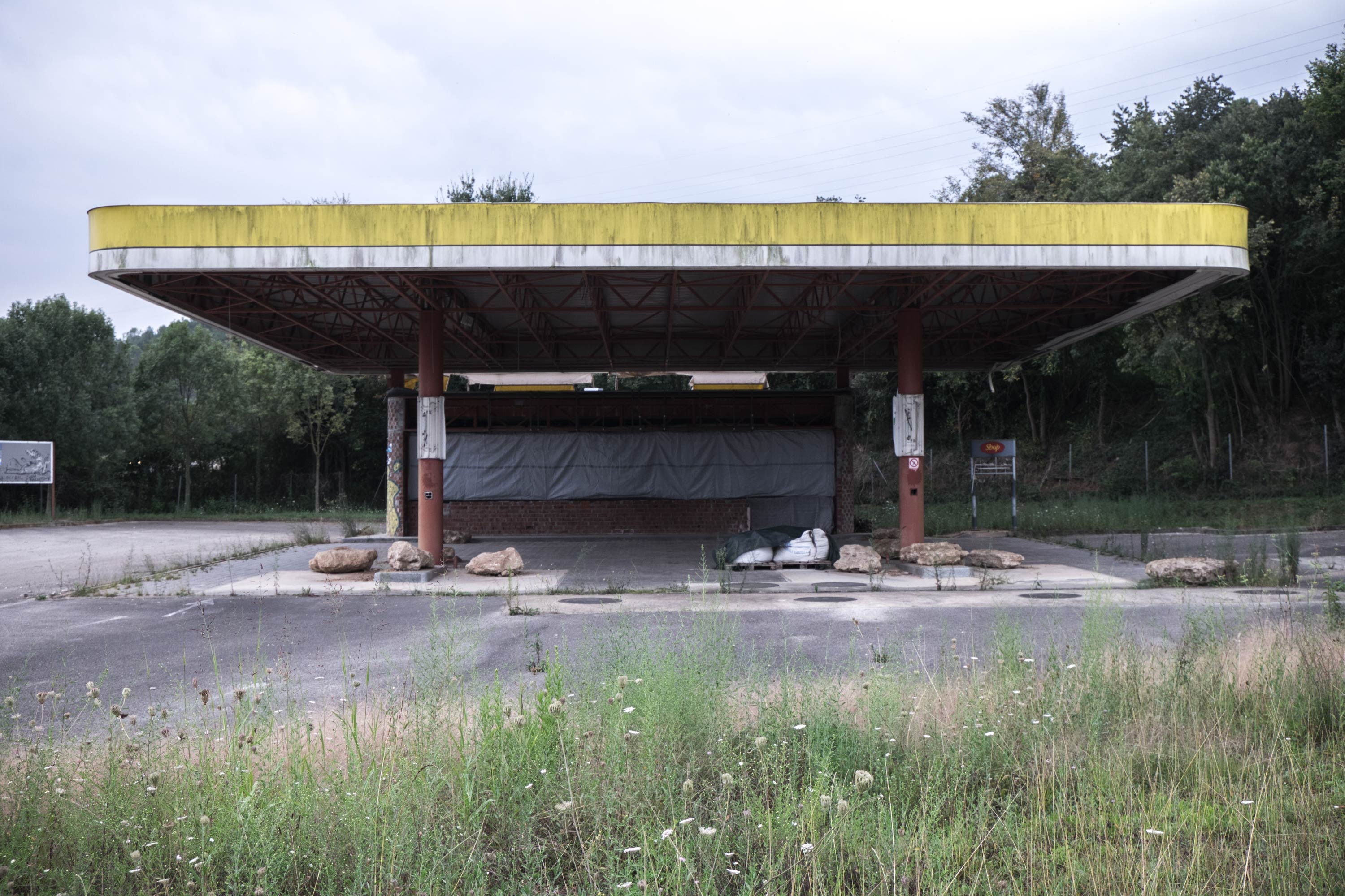 An abandoned gas station in the middle of nowhere