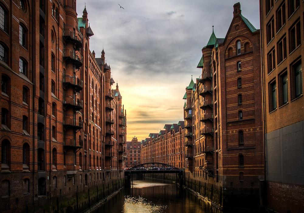 river between brown concrete buildings