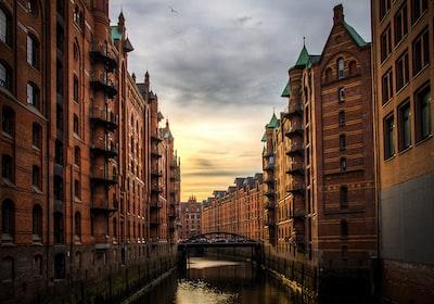 river between brown concrete buildings germany zoom background