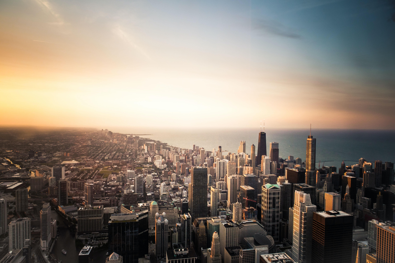 A sprawling city skyline during sunset
