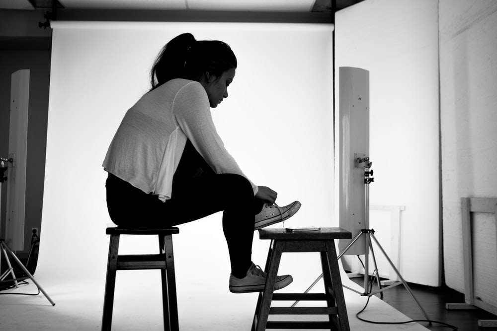 women wearing cardigan grey-scale photography
