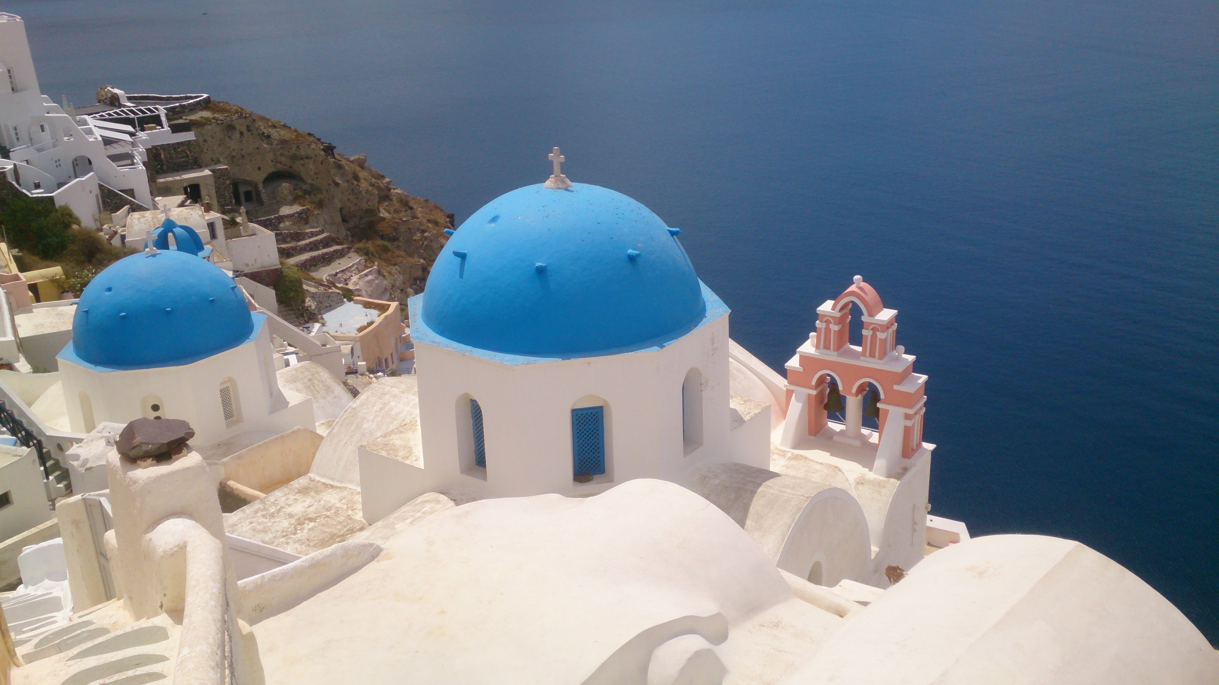Blue and white rooftops of classic Greek buildings on the seashore