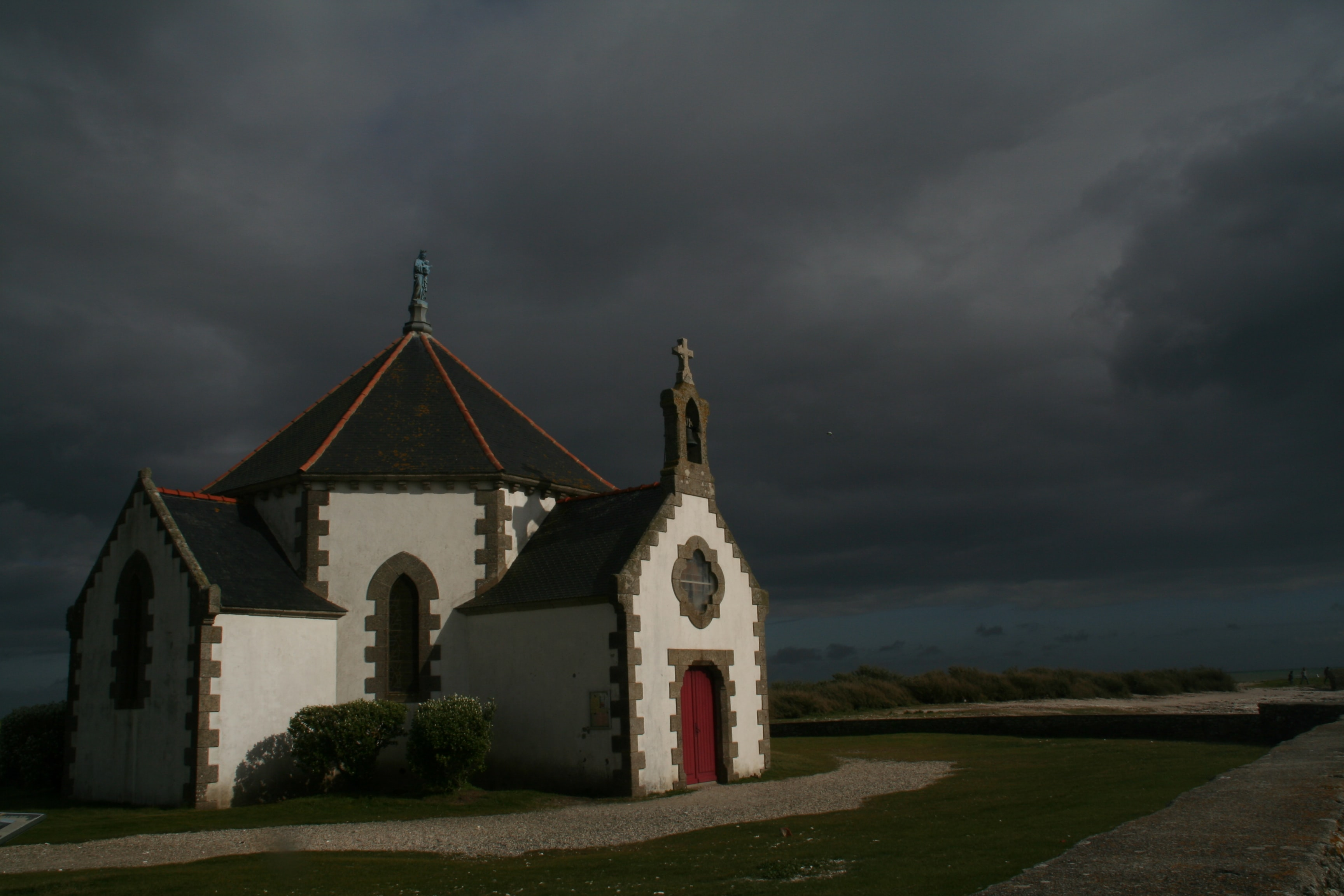 Storm clouds rolls in the sky over an isolated church
