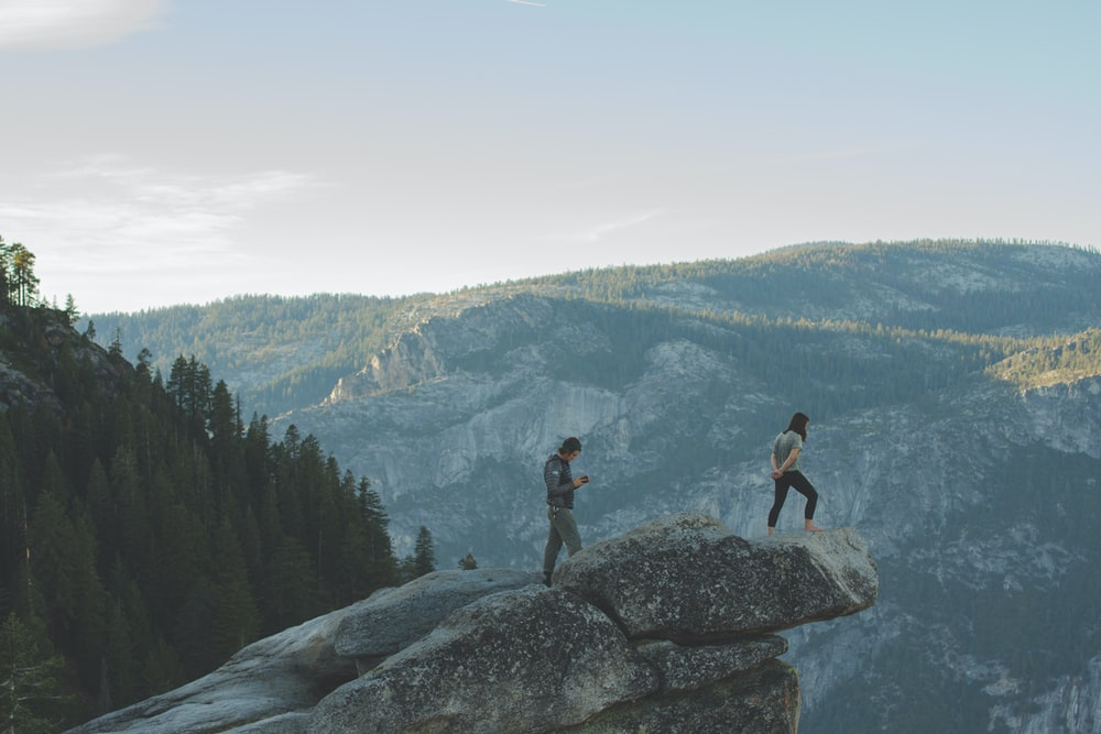 two men on mountain edge