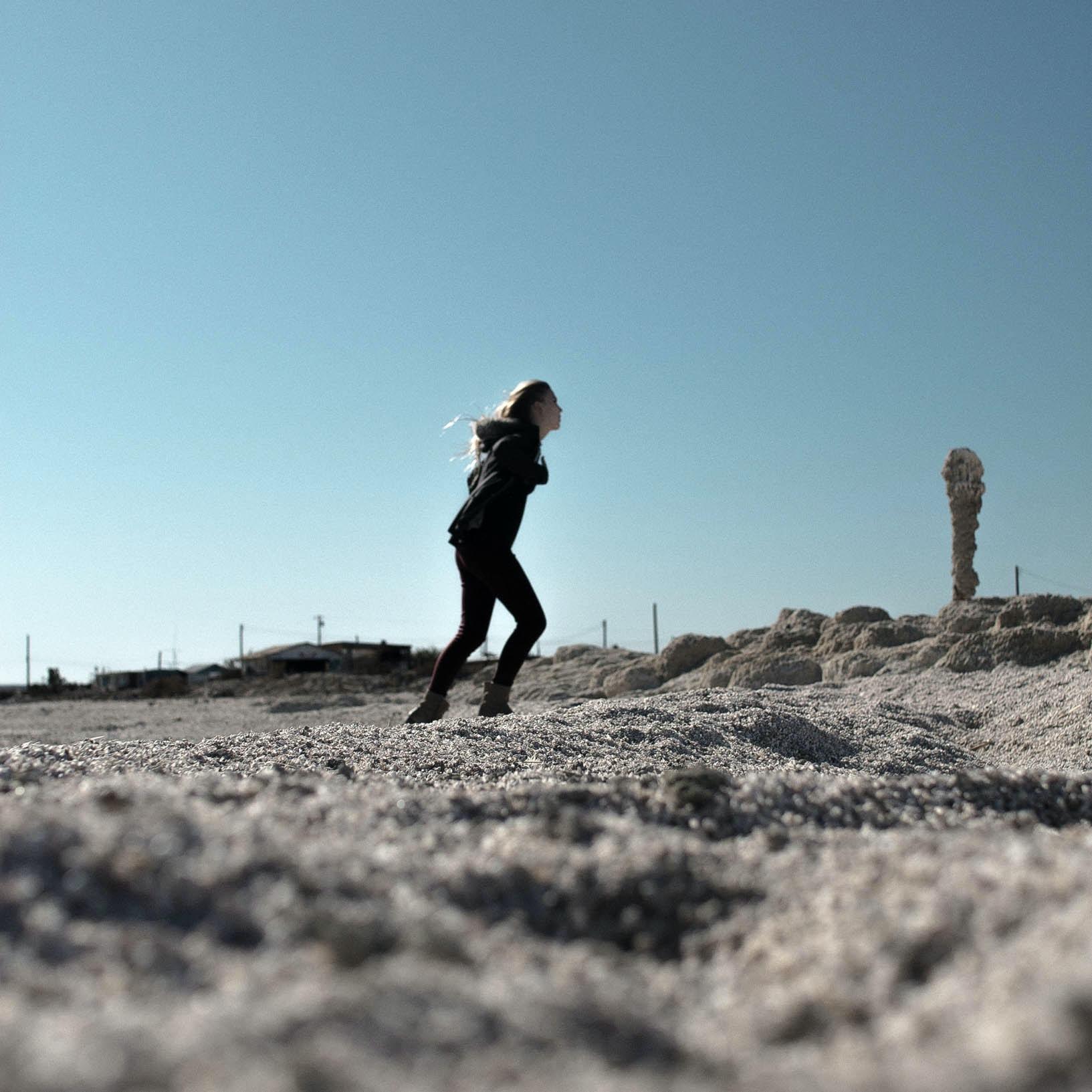 woman jogging on field