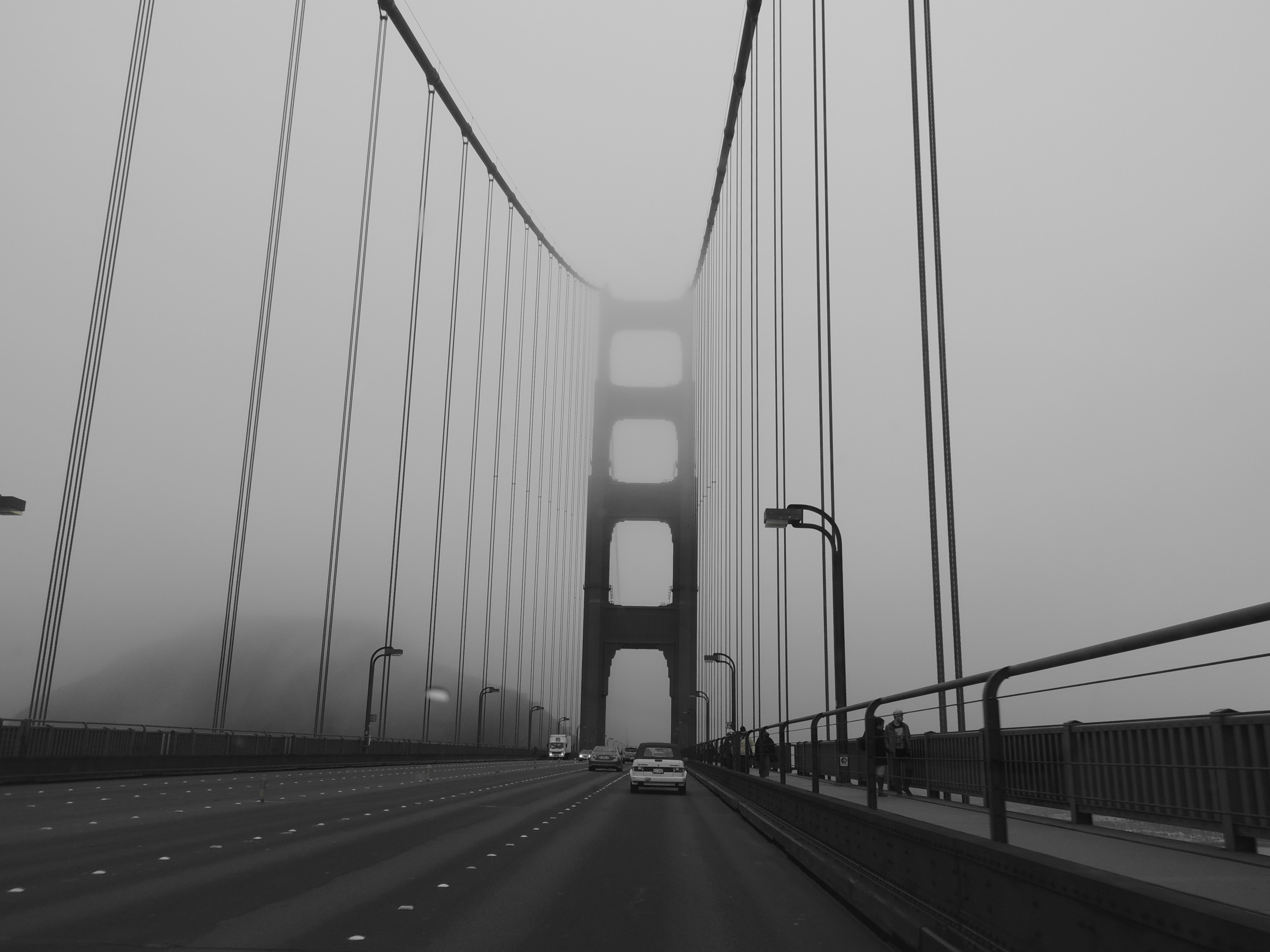 cars on bridge grayscale photo