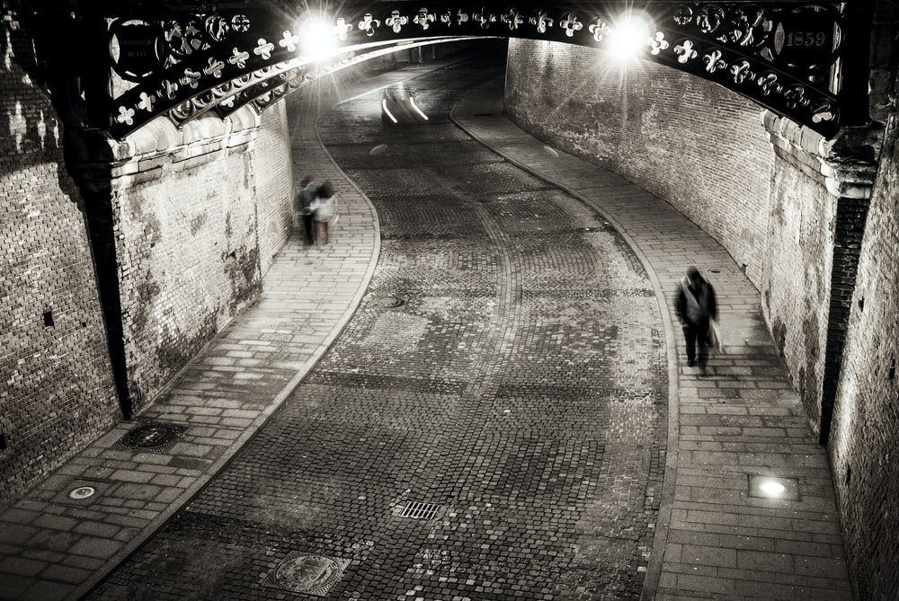 gray-scale photo of man walking