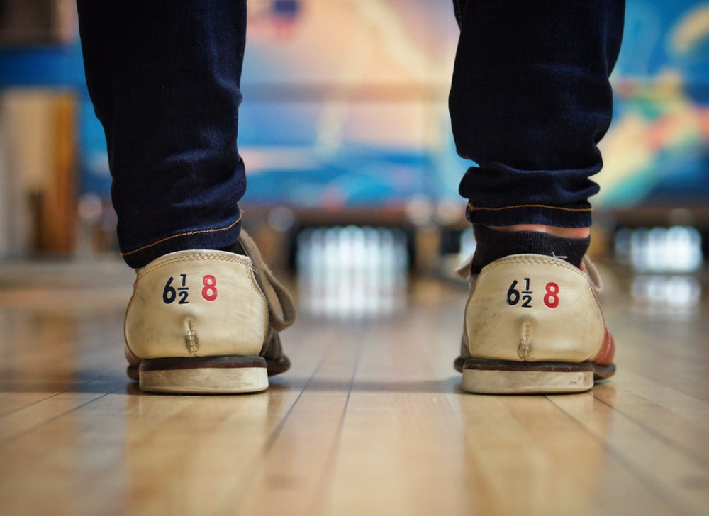 person standing on bowling court